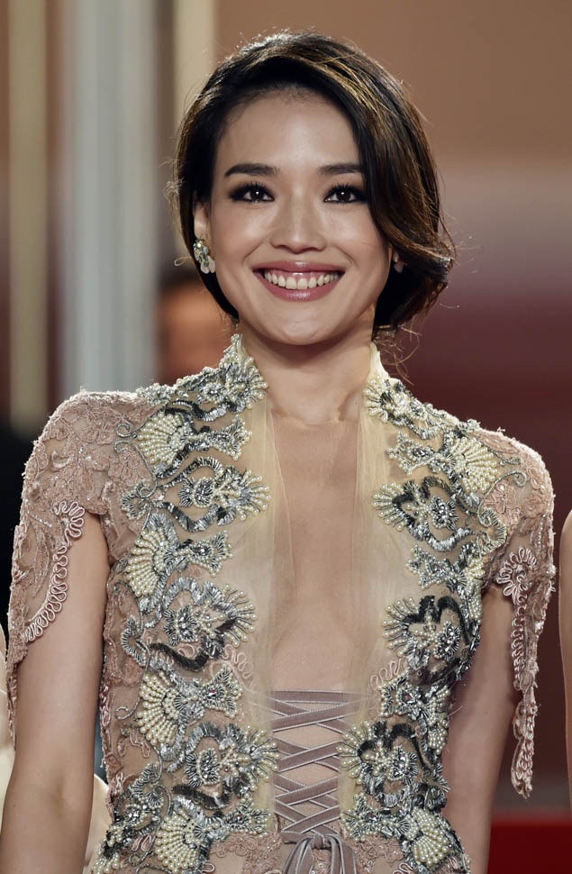 """Taiwanese actress Shu Qi smiles as she arrives for the screening of the film """"Nie Yinniang"""" (The Assassin) at the 68th Cannes Film Festival in Cannes, southeastern France, on May 21, 2015.   AFP PHOTO / BERTRAND LANGLOIS        (Photo credit should read BERTRAND LANGLOIS/AFP/Getty Images)"""