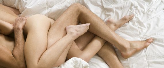 Couple in bed without clothes being intimate.