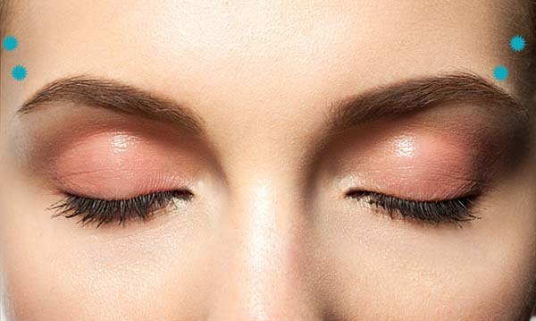 Close-up eyes closed with makeup with brown eyebrows and black lashes