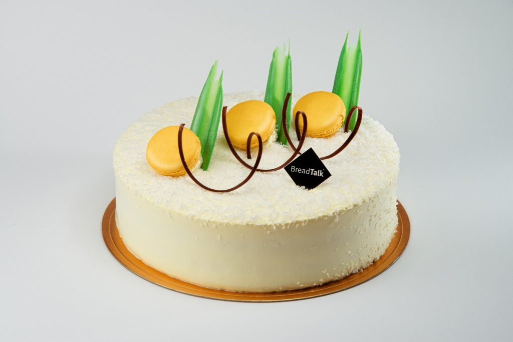 A cake sitting on top of a table  Description automatically generated